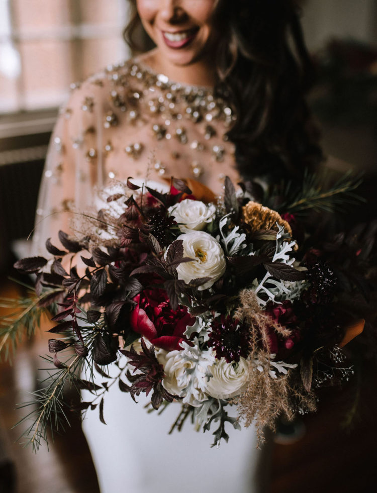 The wedding bouquet was a dark one with pale details and herbs, it was textural and chic