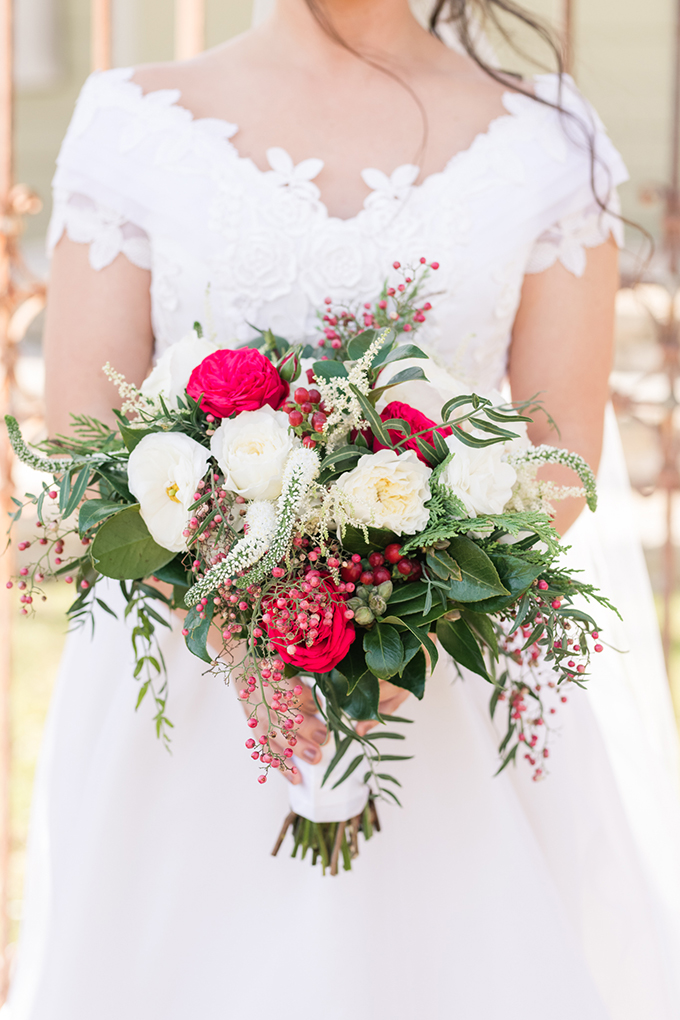 The wedding bouquet was done in traditional green, red and white, with berries and various textures