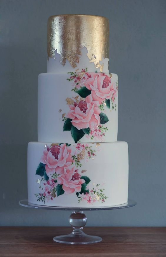 a bold and chic wedding cake with a top gold foil tier and two beautiful handpainted ones plus gold foil touches