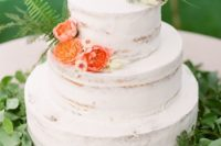 04 a naked wedding cake with coral blooms, ferns and gilded fox toppers is a great and fresh summer idea
