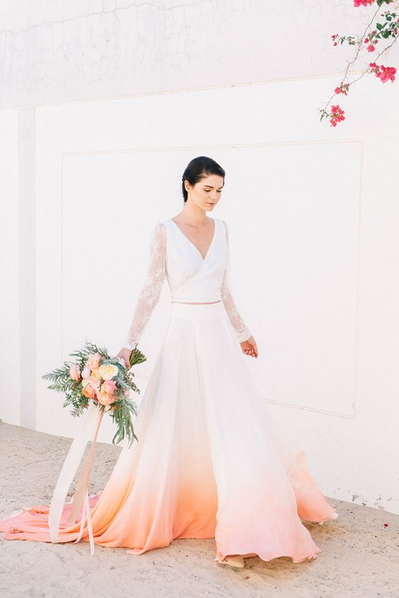 a neutral wedding dress with an ombre peachy skirt from orange to peachy pink is a cool statement