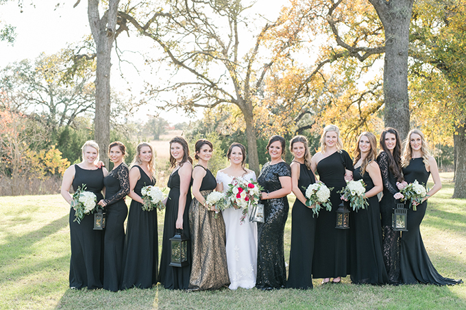 The bridesmaids were wearing mismatching black maxi gowns and the maids of honor were rocking gowns with a touch of sparkle