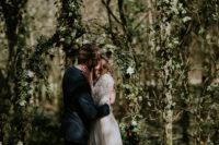 woodland-styled wedding arch