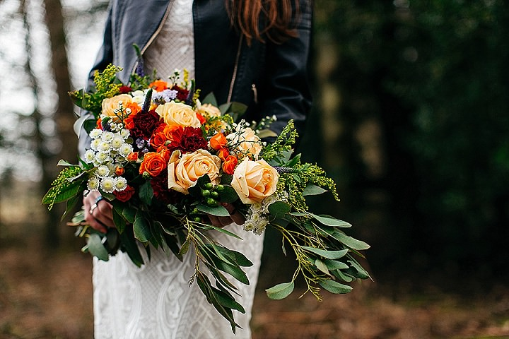 The wedding bouquet was a colorful one with a fall palette and much greenery