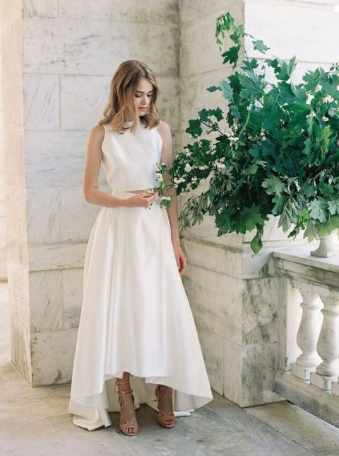 a minimalist wedding separate with a halter neckline crop top and a high low skirt