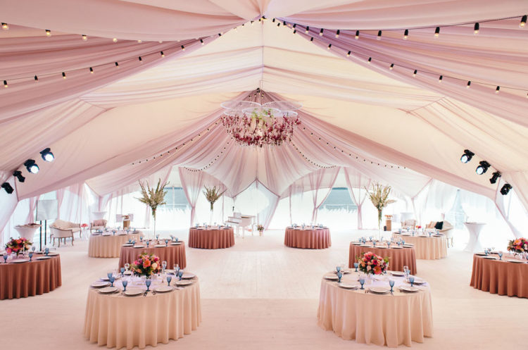 A huge tent by the lake was done in rosy shades to become their reception space