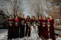 06 The bridesmaids were wearing burgundy velvet maxi gowns with long sleeves and high necklines