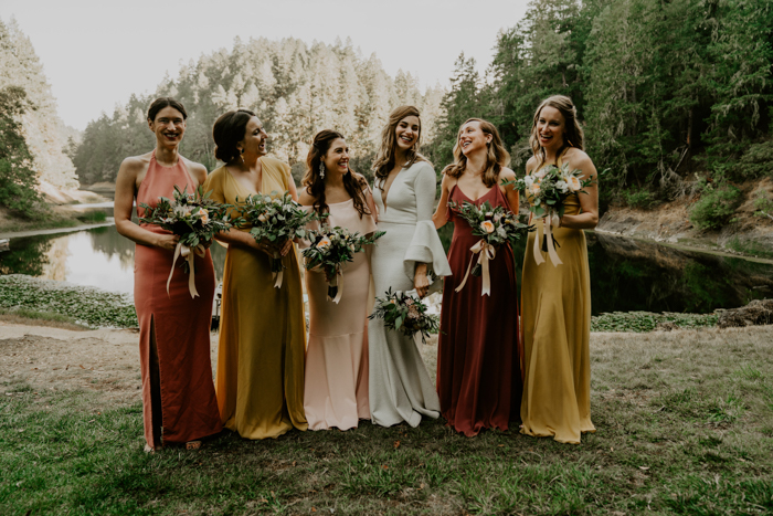 The bridesmaids were wearing mismatching gowns in muted fall shades