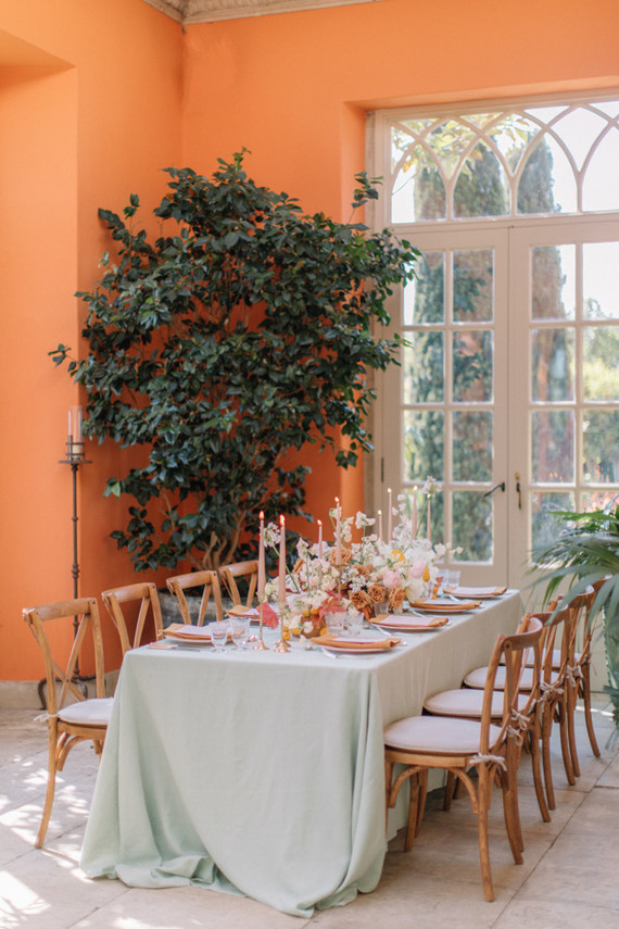 The reception took place in an orangery, the color palette was done of orange, pink and mint tones