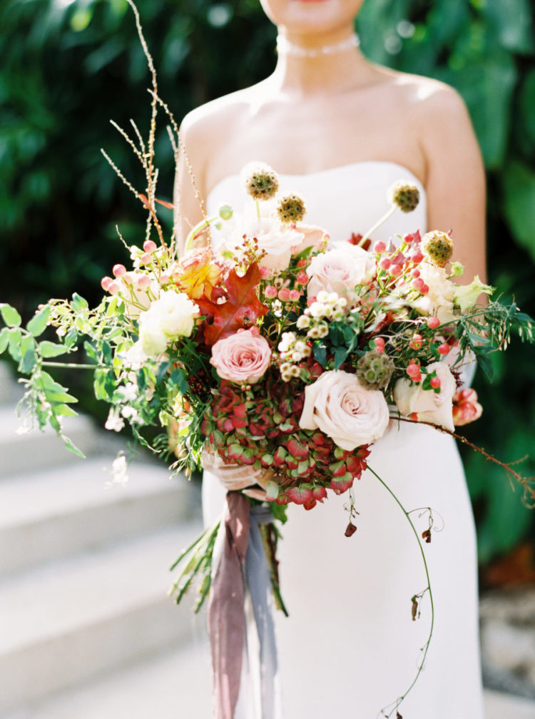 The wedding florals were super bright and colorful, with much texture and long ribbons