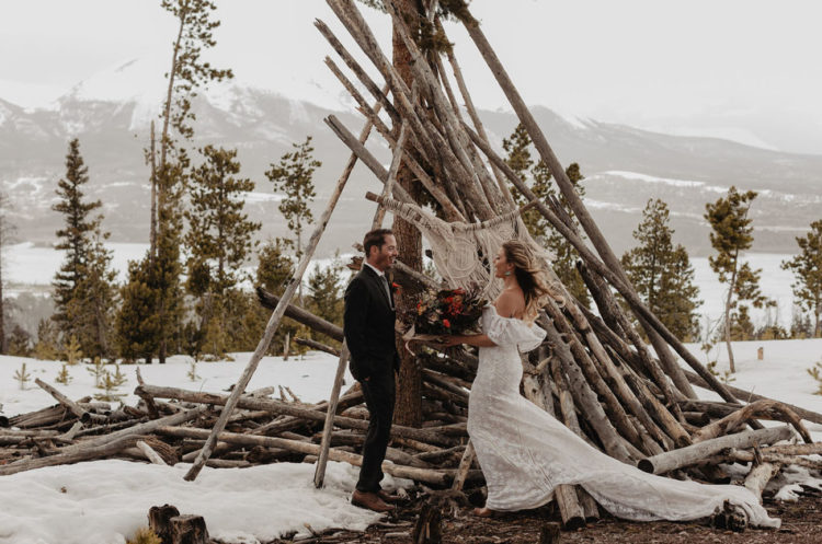 Their ceremony took place at an altar of branches done with a fug and a macrame hanging