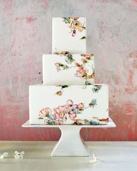 a chic square handpainted floral wedding cake in red, ornage and greens is amazing for a subtle spring wedding