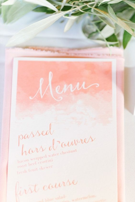 a watercolor ombre coral wedding menu with calligraphy is a bold and trendy idea with its color and design