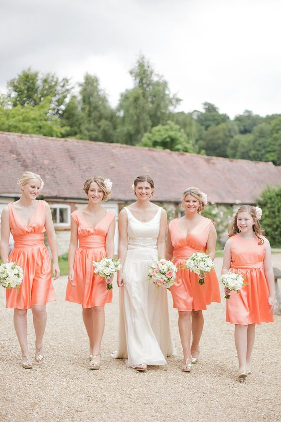 coral silk knee bridesmaid dresses with draped bodices and V-necklines is a chic and bright idea
