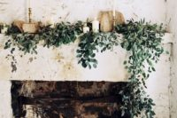 06 decorate your fireplace with candles and greenery if it's a non-working hearth