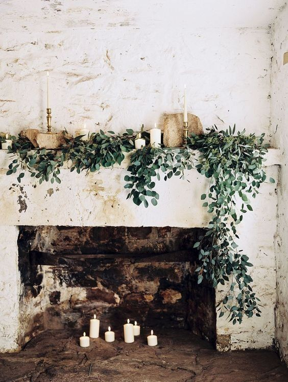 decorate your fireplace with candles and greenery if it's a non-working hearth
