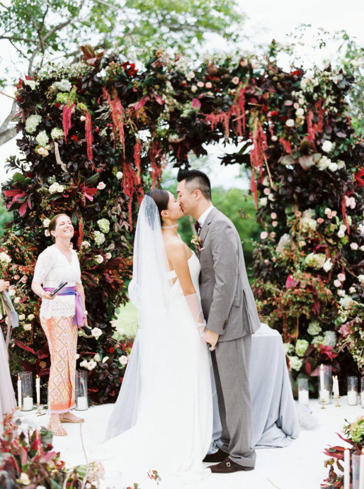 The wedding arch was very impressive, with lots of dark and bright blooms and much green and dark foliage
