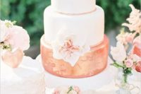 07 a cool and bold wedding cake with white tiers and a coral and gold tier plus a sugar bloom
