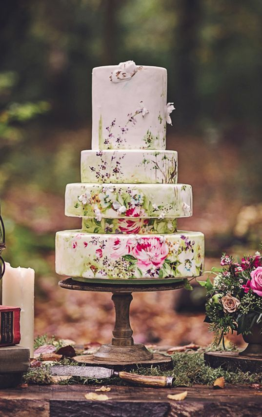 a creative hand painted wedding cake done of different tiers to make it catchy and even whimsy