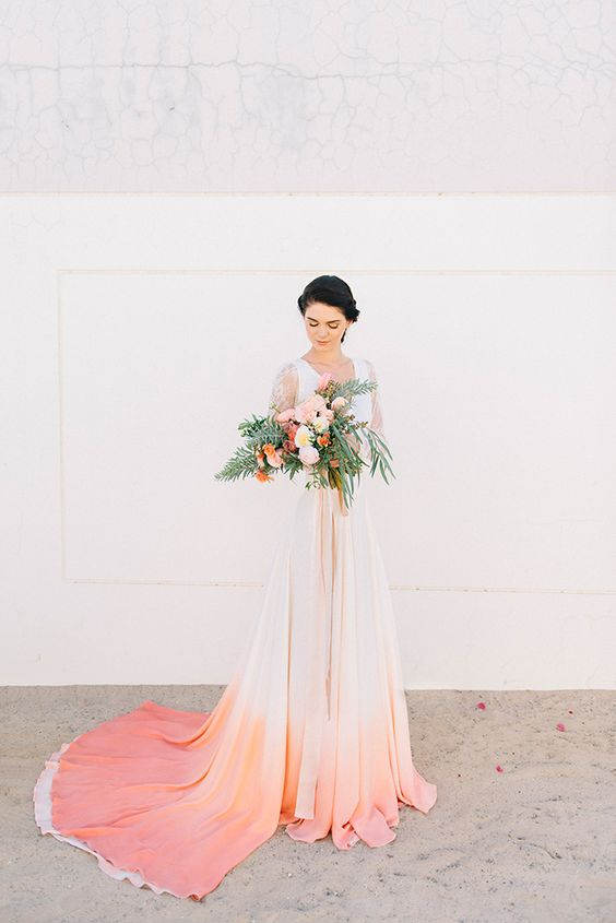 a wedding dress with a dip dyed ombre skirt in coral and pink is a great modern idea to try