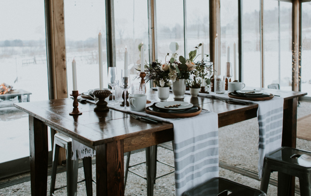 simple linens, candles and neutral porcelain and blooms are great for decorating a reception table with a hygge feel