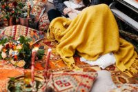 08 The wedding picnic was styled with super colorful and printed blankets, rugs, pillows, lanterns and candles and lush florals