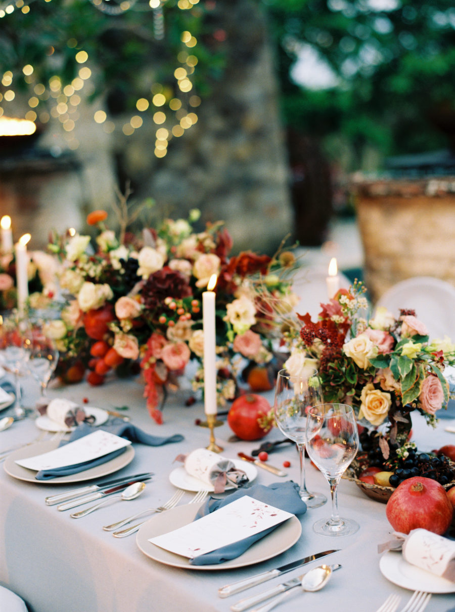 The wedding tablescape was done in blues, with rich florals, candles and fruits for table runners