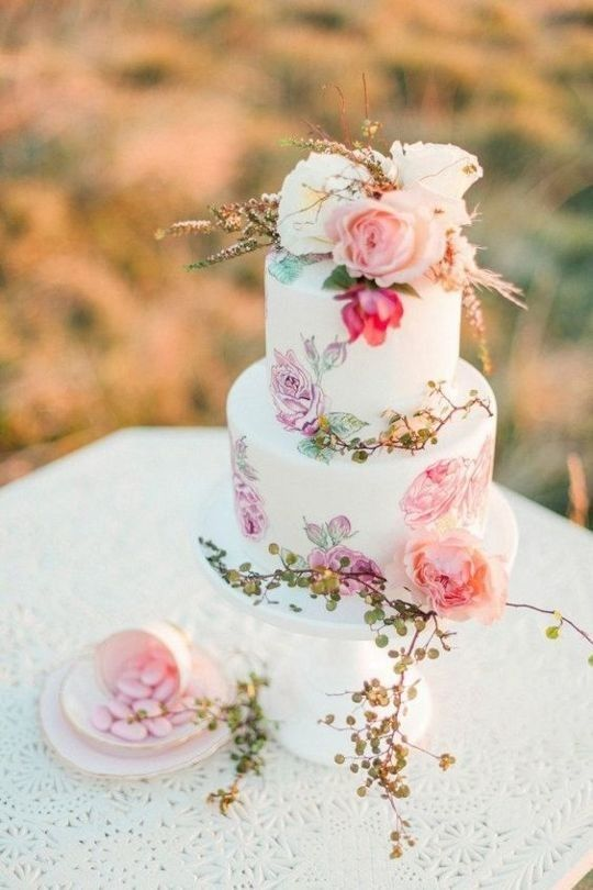 a colorful handpainted wedding cake with pink and lilac blooms and fresh blooms on top is amazing for summer
