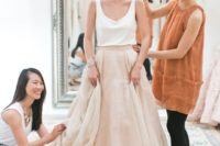 08 a very casual bridal separate with an off-white top and a blush layered amxi skirt for a brunch wedding
