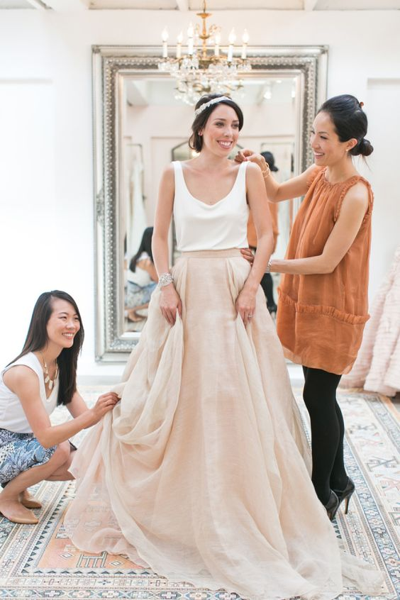a very casual bridal separate with an off white top and a blush layered amxi skirt for a brunch wedding