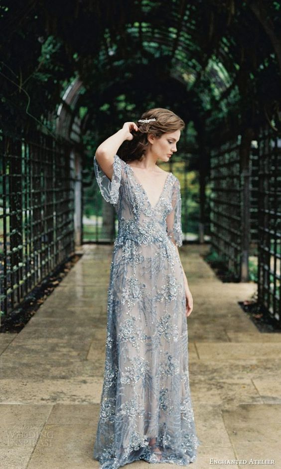 a very romantic embellished and embroidered blue wedding gown with a deep V neckline and short sleeves