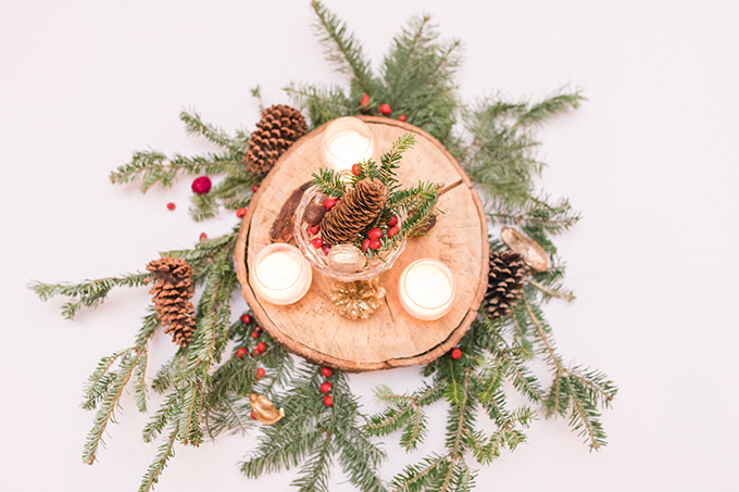 The centerpieces were made of wood slices, pinecones, evergreens, candles and berries