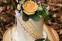 09 The wedding cake was a buttercream one decorated with scales, feathers and fresh blooms