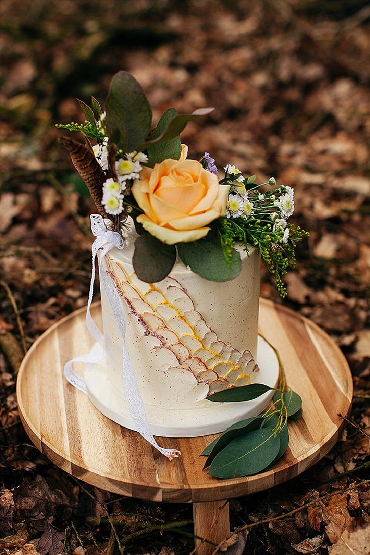 The wedding cake was a buttercream one decorated with scales, feathers and fresh blooms