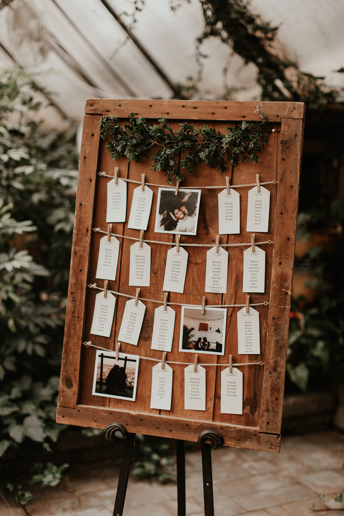 The wedding seating chart was done with the couple's photos and fresh greenery