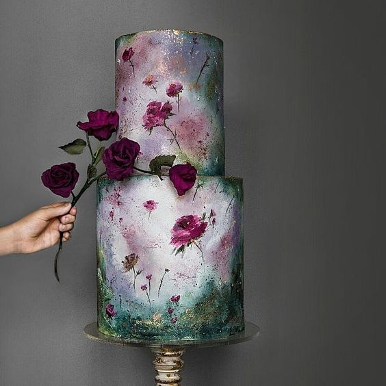 a dramatic moody floral wedding cake in purple, emerald and with gold touches is ideal for a moody wedding