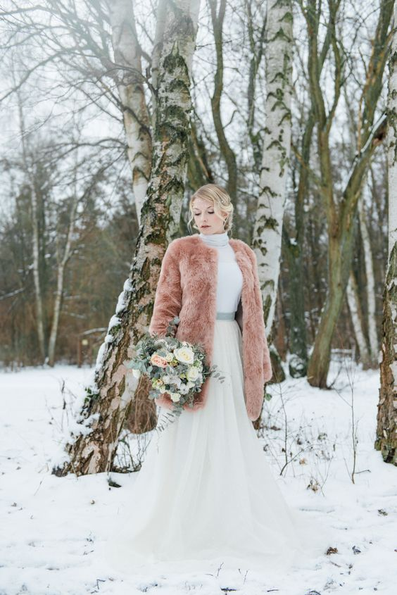 a peachc-olored teddy coat is a gorgeous way to add color to your look and stand out in the snow