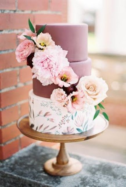a chic summer wedding cake with two burgundy tiers and a handpainted floral tier plus fresh bloom decor