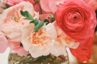 10 a colorful wedding centerpiece of a vase with gold sequins and blush and coral blooms is a great summer idea