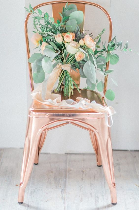 a copper chair and a sweet peach rose and lush greenery proves that such a color combo is a very tender and soft one