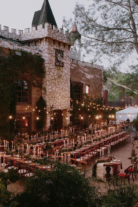 a magical reception space with candles and lights for a Harry Potter themed wedding