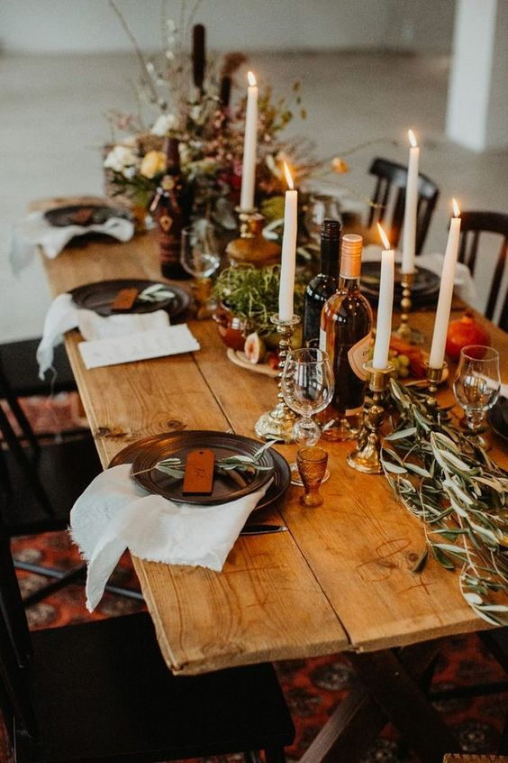 lush and simple greenery and herbs and simple linens paired with an uncovered table feel very hygge