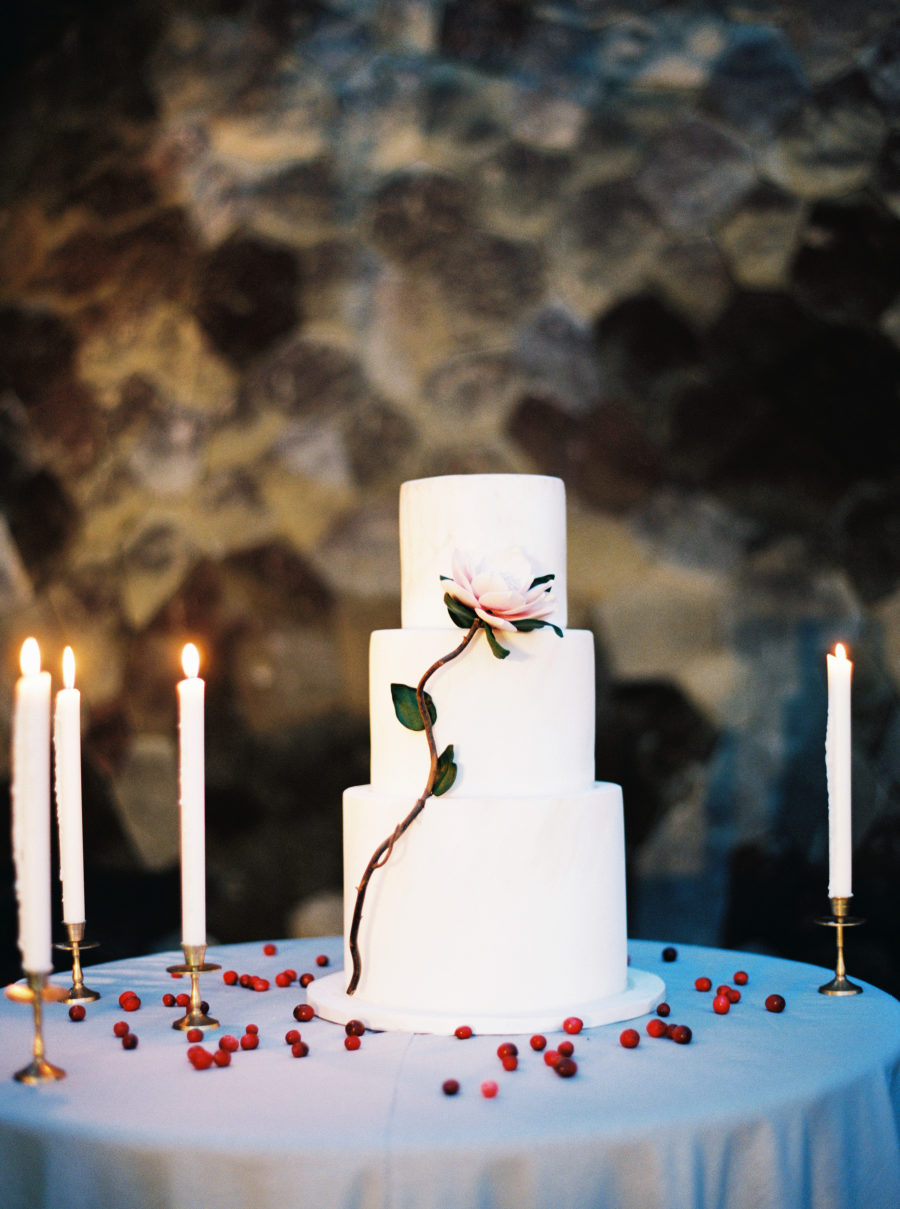 super modern all white wedding cake with a bloom