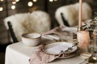 11 a wedding tablescape done in soft neutral and blush tones, with vintage ceramics and candles is a very hygge idea