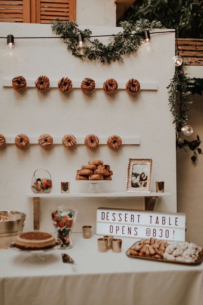 The dessert table included a trendy donut wall and lots of candies and some pies