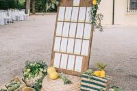 12 a stylish seating chart decorated with lemons, greenery, artichokes, striped textiles to feel Mediterranean