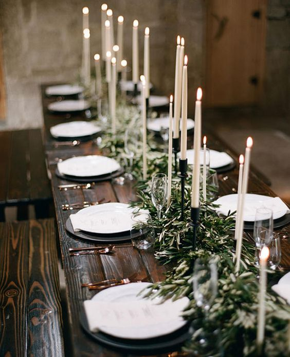 elegant tall candles are what you need to make your wedding decor more hygge