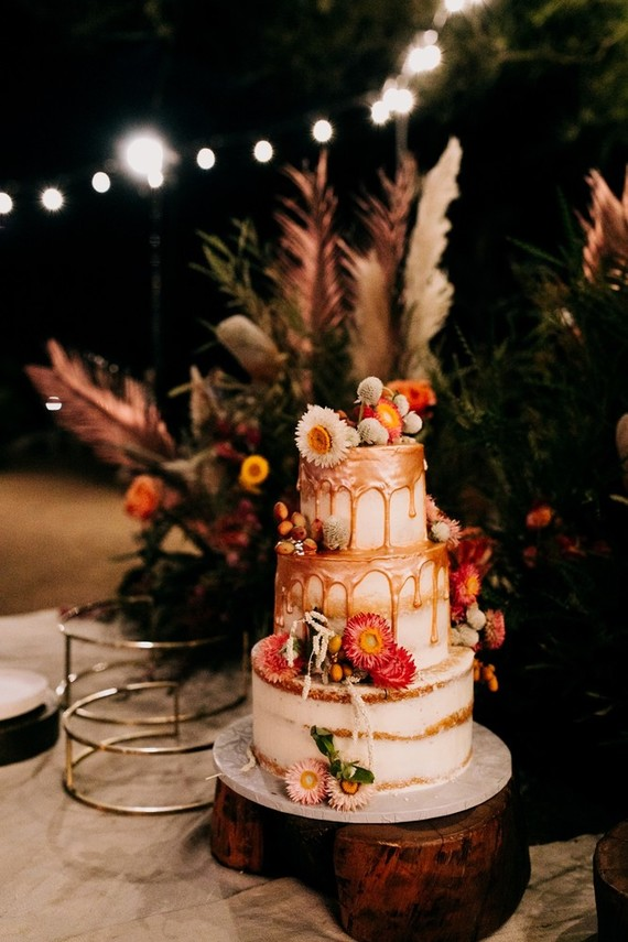 The wedding cake was a naked one with copper dipping, strawflowers and berries and nuts