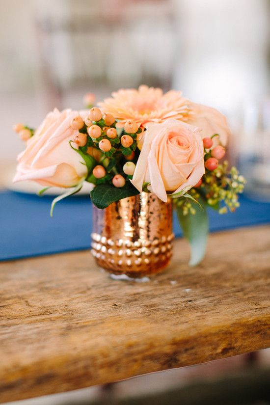 gorgeous floral arrangement in a copper vase