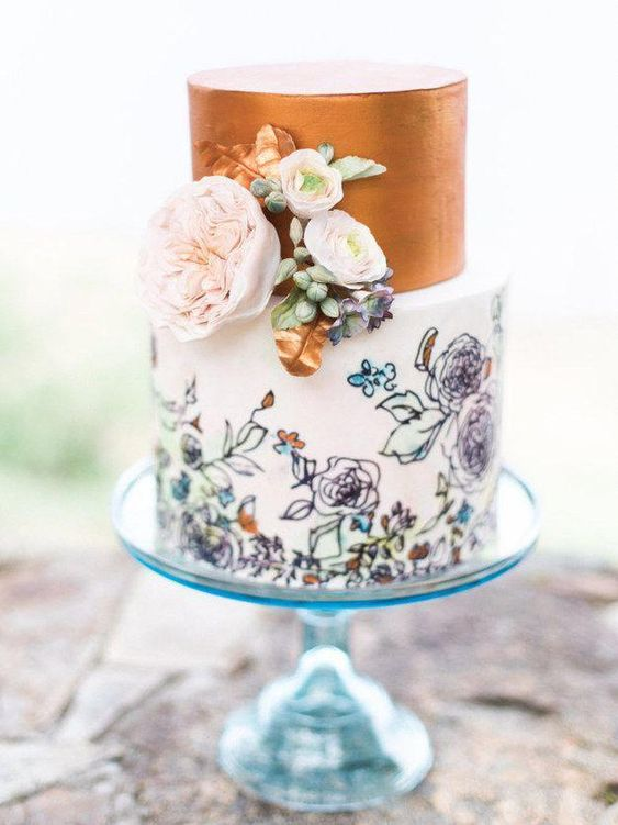 a trendy wedding cake with a copper leaf tier and a pastel handpainted floral tier plus fresh blooms for decor